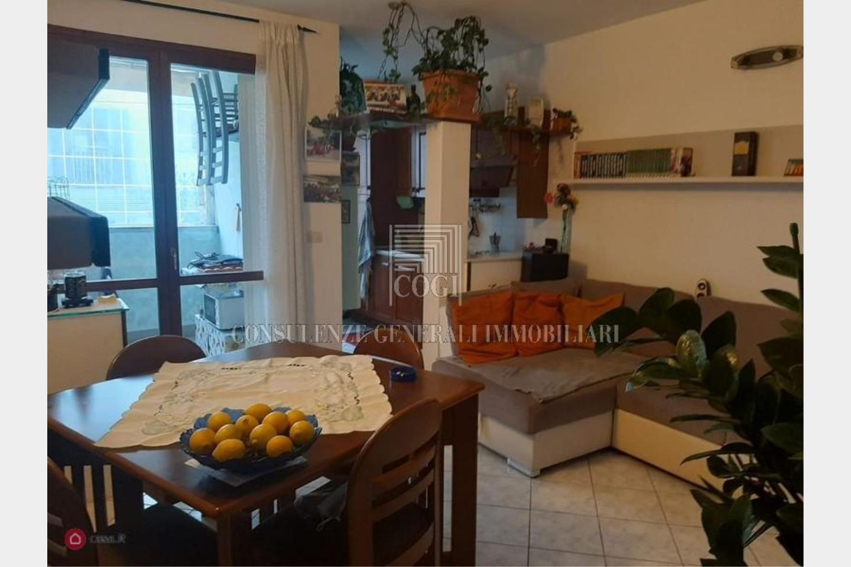 sala con cucina in nicchia